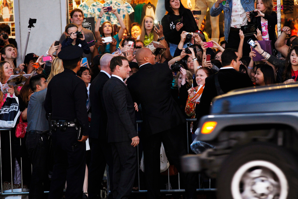 ". Cast member Dwayne Johnson (C) signs autographs at the premiere of ""G.I. Joe: Retaliation\"" in Hollywood, California March 28, 2013. The movie opens in the U.S. on March 28.   REUTERS/Mario Anzuoni"