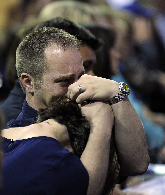 . People break into tears during a memorial service at Baylor University in Waco, Texas, on April 25, 2013 for the firefighters who were killed in a huge blast at a Texas fertilizer plant last week. AFP PHOTO/Jewel  SAMAD/AFP/Getty Images
