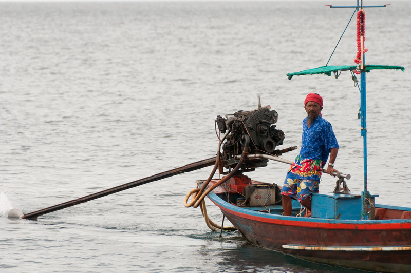 Profile of a man on a motorized fishing boat in Ko Samui, Thailand