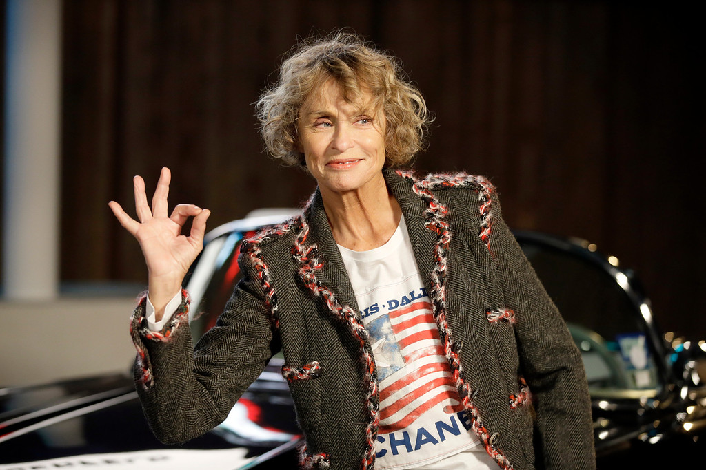 . Model and actress Lauren Hutton poses for photos after arriving for Chanel\'s Metiers d\'Art fashion show, Tuesday, Dec. 10, 2013, in Dallas. (AP Photo/Tony Gutierrez)