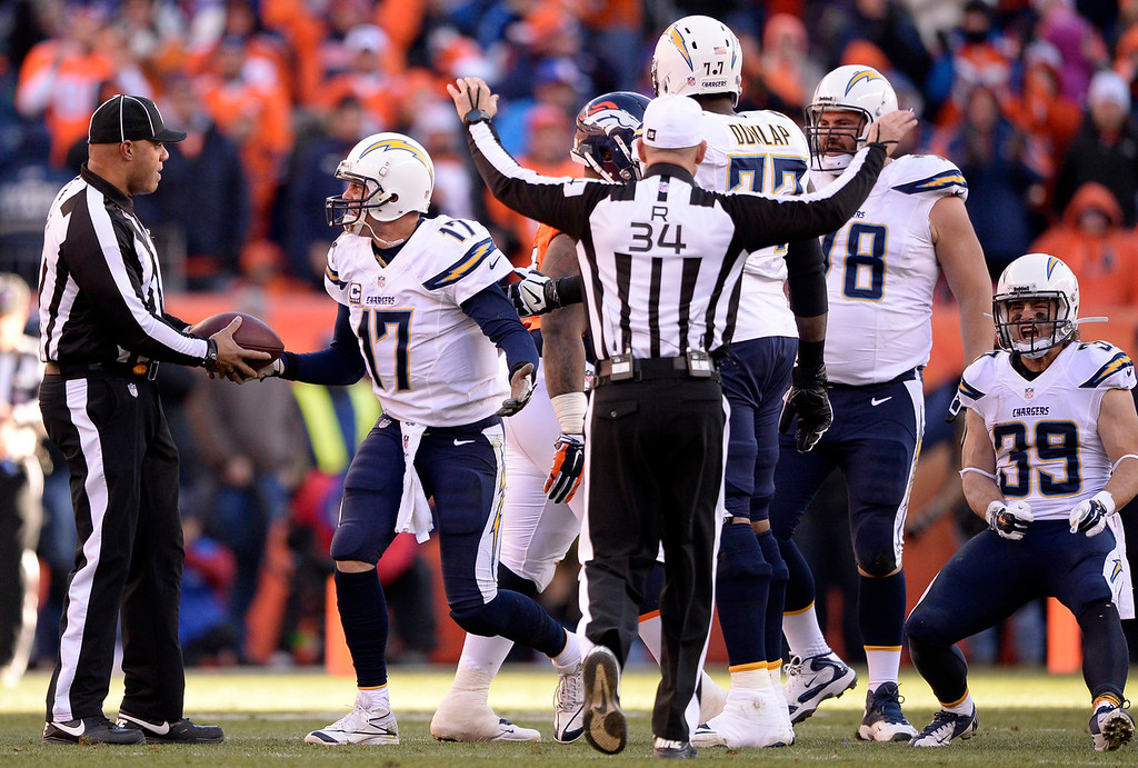 . San Diego Chargers quarterback Philip Rivers (17) complains to the ref after getting sacked during the second quarter. The Denver Broncos vs. The San Diego Chargers in an AFC Divisional Playoff game at Sports Authority Field at Mile High in Denver on January 12, 2014. (Photo by John Leyba/The Denver Post)