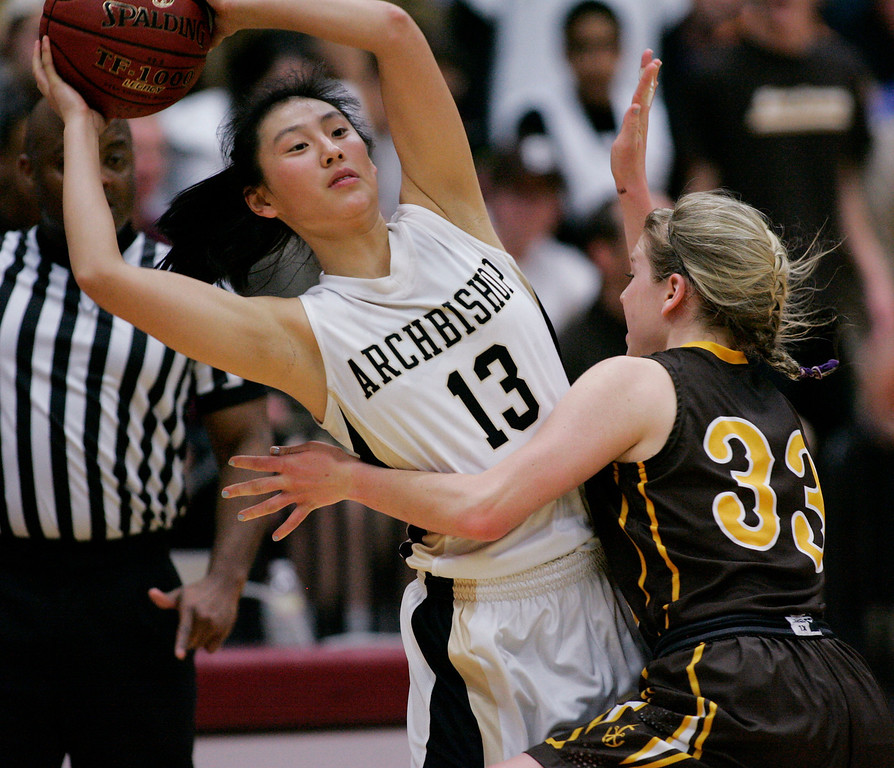 . Mitty\'s Regina Chi passes around St. Francis\' Kate Hoey in the fourth quarter during the CCS Open Division girls basketball finals at Santa Clara University in Santa Clara, Calif. on Saturday, March 2, 2013. The Archbishop Mitty Monarchs beat the Saint Francis Lancers, 41-32. (Jim Gensheimer/Staff)