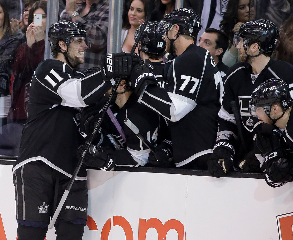 . Los Angeles Kings center Anze Kopitar, left, celebrates his game-winning goal during a shootout in an NHL hockey game against the Colorado Avalanche, Saturday, Dec. 21, 2013, in Los Angeles. (AP Photo/Chris Carlson)