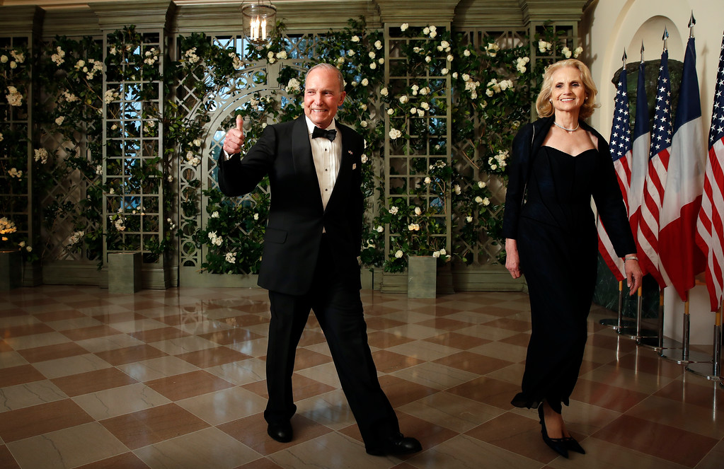 . National Economic Council director Lawrence Kudlow and Judith Kudlow arrive for a State Dinner with French President Emmanuel Macron and President Donald Trump at the White House, Tuesday, April 24, 2018, in Washington. (AP Photo/Alex Brandon)