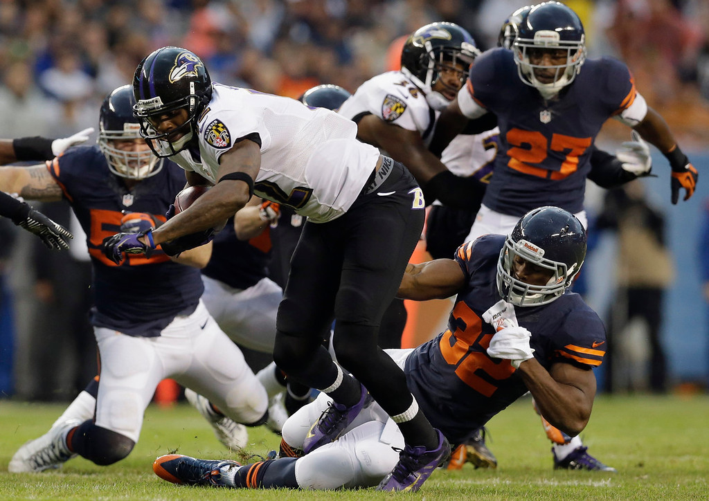 . Baltimore Ravens\' Jacoby Jones is tackled on a punt return by Chicago Bears\' Michael Ford (32) during the first half of an NFL football game, Sunday, Nov. 17, 2013, in Chicago. (AP Photo/Nam Y. Huh)