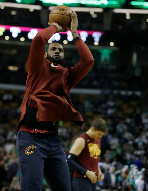 . Cleveland Cavaliers forward LeBron James warms up before Game 2 of the NBA basketball Eastern Conference finals against the Boston Celtics, Tuesday, May 15, 2018, in Boston. (AP Photo/Charles Krupa)