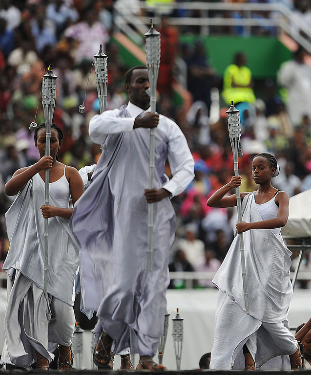 . Performers enter the Amahoro stadium in Kigali on April 7,2014, during a ceremony marking the 20th anniversary of Rwanda\'s genocide.  AFP PHOTO / SIMON MAINA/AFP/Getty Images