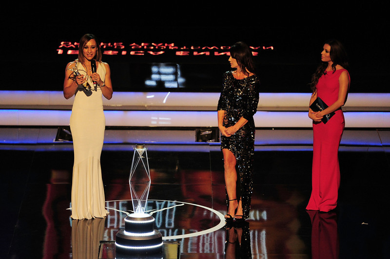 """. Track and field athlete Jessica Ennis receives her award for \""""Laureus Sportswomen of the Year\""""  as presenters  Laureus Academy Member Nadia Comaneci and Eva Longoria look stand by on stage during the awards show for the 2013 Laureus World Sports Awards at the Theatro Municipal Do Rio de Janeiro on March 11, 2013 in Rio de Janeiro, Brazil.  (Photo by Jamie McDonald/Getty Images For Laureus)"""
