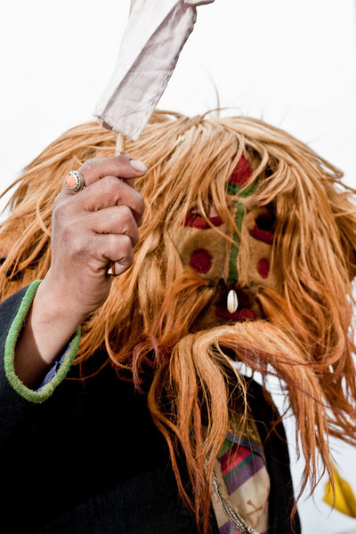 A masked figure at the festival