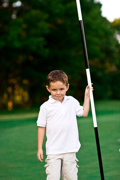 Grant holding golf flag.jpg