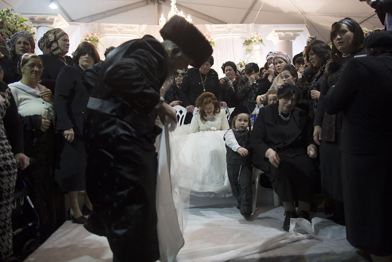 . A Jewish bride takes part in the ceremony during her wedding to the great-grandson of the Rabbi of the Tzanz Ultra-Orthodox Hasidic community in Netanya, on January 1, 2013. MENAHEM KAHANA/AFP/Getty Images