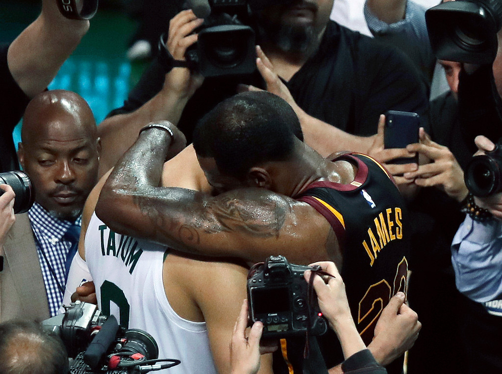 . Cleveland Cavaliers forward LeBron James embraces Boston Celtics forward Jayson Tatum after the Cavaliers beat the Celtics 87-79 in Game 7 of the NBA basketball Eastern Conference finals, Sunday, May 27, 2018, in Boston. (AP Photo/Charles Krupa)