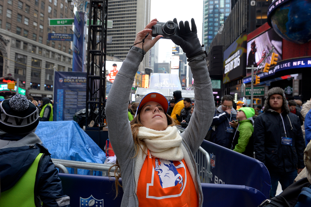 Description of . Broncos fan Allison Delevil, of Las Vegas, NV, makes a picture while visiting Times Square in New York, NY January 31, 2014. The NFL has transformed 13 blocks of Broadway into Super Bowl Boulevard before Sundays Super Bowl between the Denver Broncos and Seattle Seahawks.  (Photo By Craig F. Walker / The Denver Post)