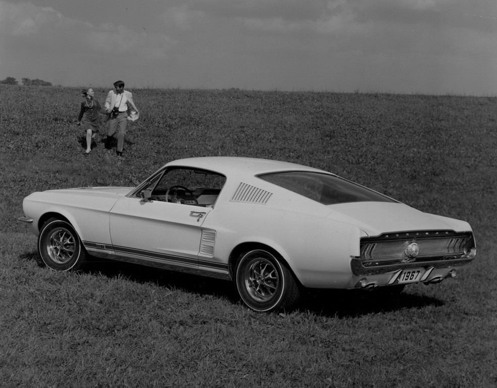 . Low and sleek, this Mustang fastback for 1967 features all-new sheet metal. The roof line has a clean, unbroken sweep downward to the distinctive, concave rear panel and functional air louvers in roof rear now are thinner. Denver Post Library photo archive