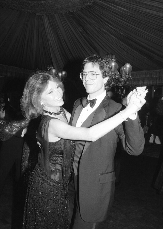 . Actress Mary Tyler Moore, 45, and her fiance, Dr. S. Robert Levine, 29, dance at tavern on the green, Nov. 9, 1983 in New York. They attended a party celebrating the opening of Bob Fosse?s film ?star 80?. The couple plans to marry on November 23. (AP Photo/Dick Drew)