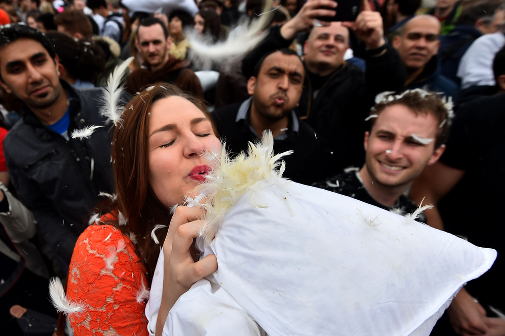 . Revelers take part in a mass pillow fight in Trafalgar Square in central London on April 5, 2014 on International Pillow Fight Day. (BEN STANSALL/AFP/Getty Images)