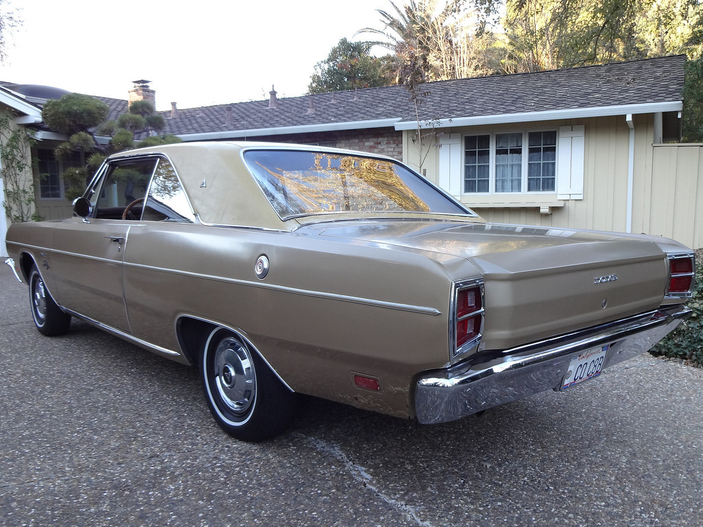 . Fred �Red� Pfeiffer of Danville shows his 1969 Dodge Dart Swinger.  (Photo by David Krumboltz)