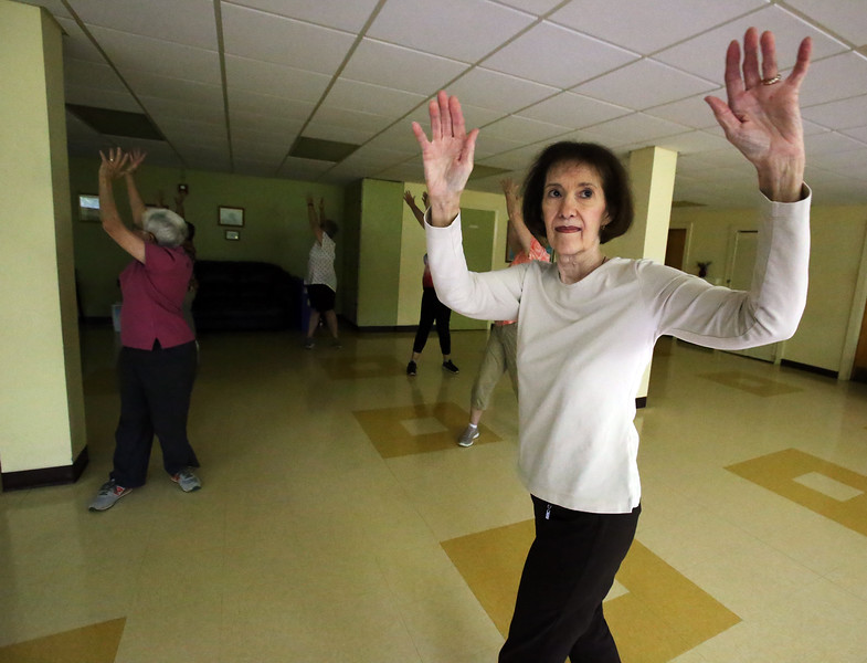 Lunch, card games and tai chi at the Dracut Council on Aging, which will be preparing seniors for the 2020 U.S. Census. Instructor June Matson of Chelmsford leads a beginner's tai chi class at the Dracut Council on Aging. (SUN/Julia Malakie)