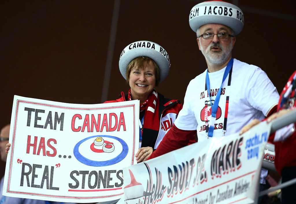 . Supporters of Canada display placards during the round robin match between Germany and Canada during the curling tournament at the Sochi 2014 Olympic Games.  EPA/Christian Charisius