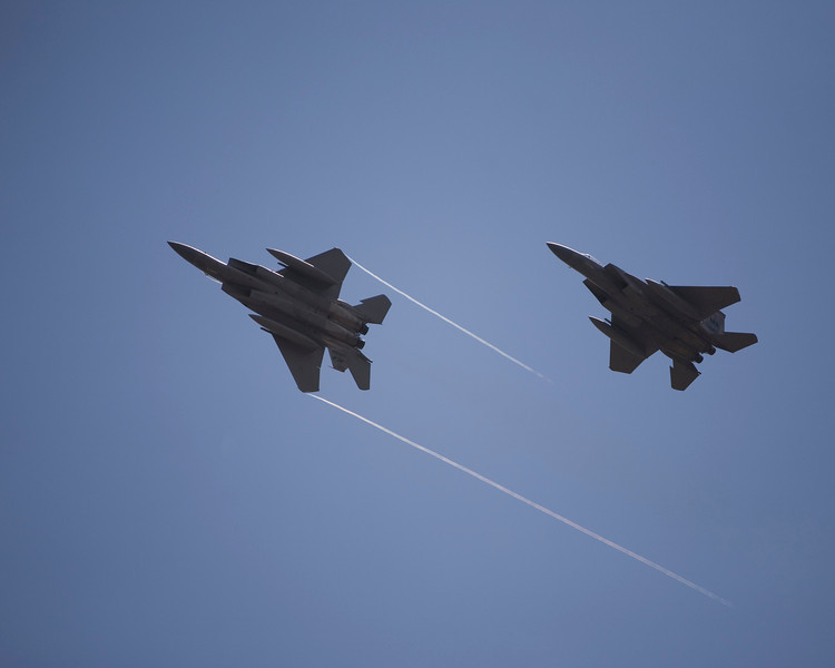 F-15 Eagles maneuvering at EAA AirVenture 2009.