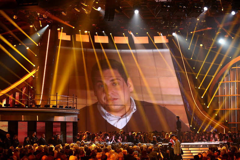 . Jonah Hill is seen onscreen presenting the trailblazer award to Emma Watson at the MTV Movie Awards in Sony Pictures Studio Lot in Culver City, Calif., on Sunday April 14, 2013. (Photo by Matt Sayles/Invision /AP)