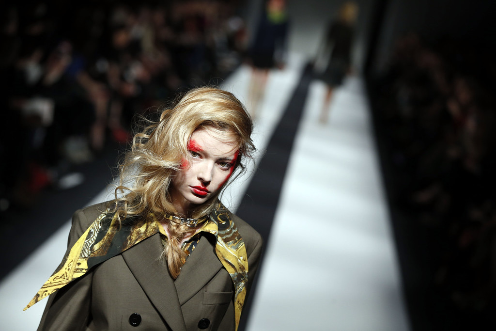 . A model wears an outfit by designer Vivienne Westwood, for the Autumn/Winter 2015 show at London Fashion Week, in London, Sunday, Feb. 22,2015. (AP Photo/Alastair Grant)