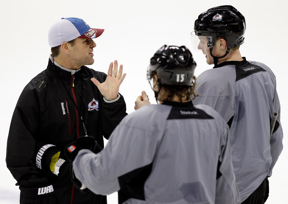 . Colorado Avalanche assistant coach David Quinn instructs the players during NHL hockey practice, Thursday Jan. 17, 2013, in Denver, Colo. (AP Photo/Brennan Linsley)