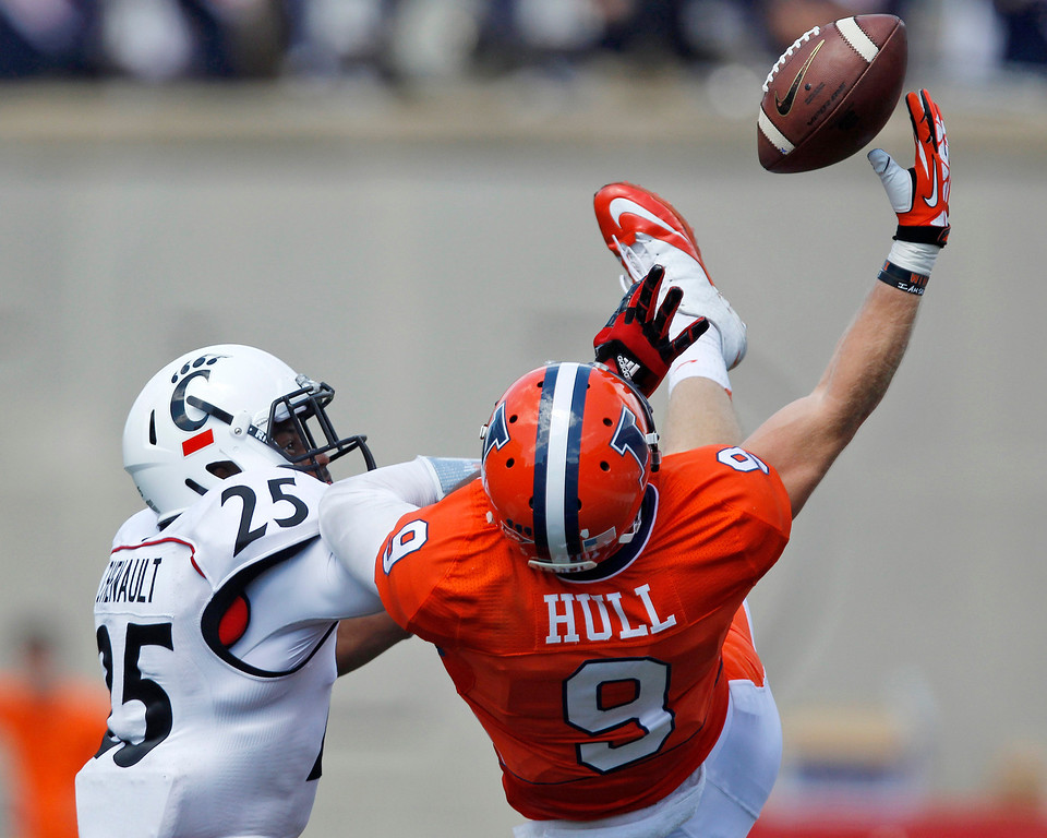 . Cincinnati safety Arryn Chenault (25) breaks up a pass to Illinois wide receiver Steve Hull (9) during the second half of their NCAA college football game on Saturday, Sept. 7, 2013, in Champaign, Ill. (AP Photo/Andrew A. Nelles)