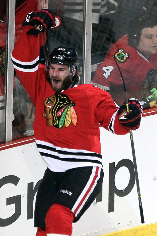 . Brandon Saad #20 of the Chicago Blackhawks celebrates after scoring a goal against Jonathan Quick #32 of the Los Angeles Kings in the first period during Game Five of the Western Conference Final in the 2014 Stanley Cup Playoffs at United Center on May 28, 2014 in Chicago, Illinois.  (Photo by Tasos Katopodis/Getty Images)