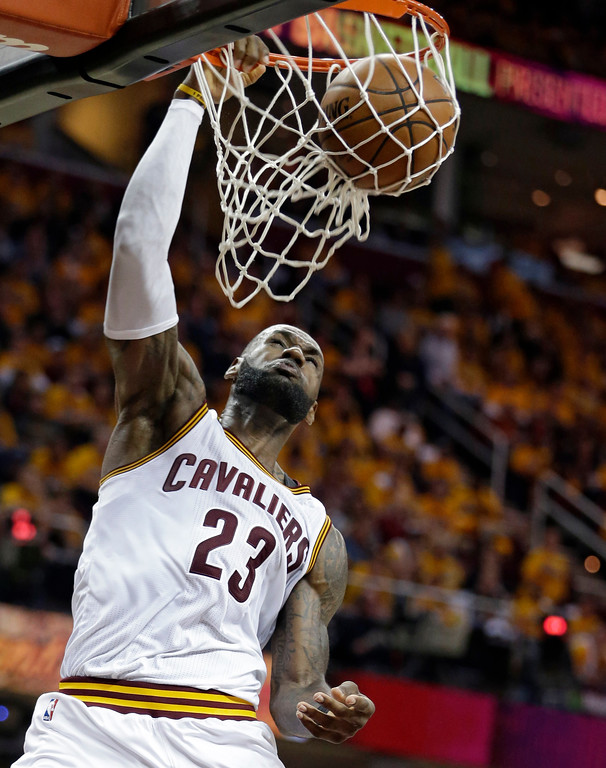 . Cleveland Cavaliers\' LeBron James dunks against the Toronto Raptors in the second half in Game 1 of a second-round NBA basketball playoff series, Monday, May 1, 2017, in Cleveland. The Cavaliers won 116-105. (AP Photo/Tony Dejak)