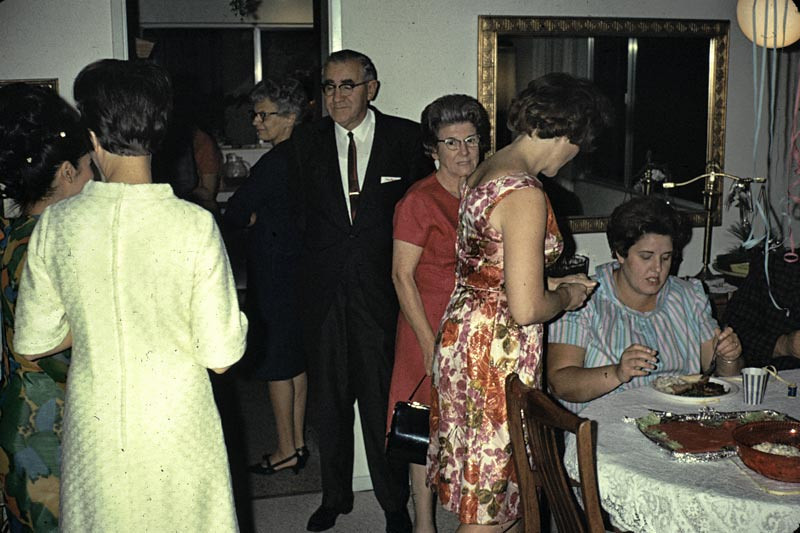 Loraine Tate and various others at a church social at the Cossentines home. The woman in the red dress is Ethel Stewart. (Help with missing names is appreciated. Just add a comment in the forum)