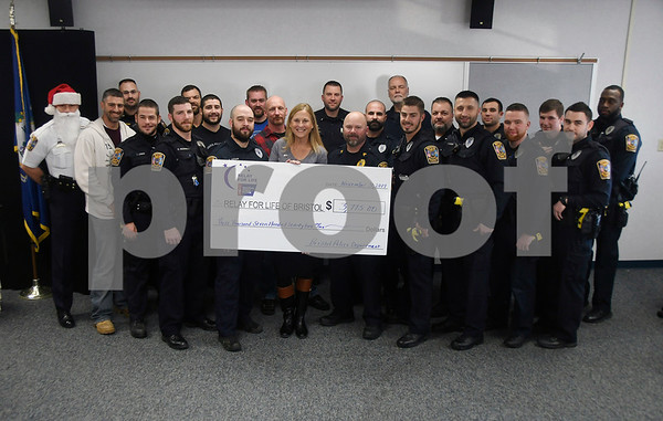 11/30/2017 Mike Orazzi | Staff Members of the Bristol police department with the nearly $4,000 they raised as part of No-Shave November.