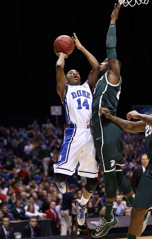 . Rasheed Sulaimon #14 of the Duke Blue Devils attempts a shot in the first half against the Michigan State Spartans during the Midwest Region Semifinal round of the 2013 NCAA Men\'s Basketball Tournament at Lucas Oil Stadium on March 29, 2013 in Indianapolis, Indiana.  (Photo by Streeter Lecka/Getty Images)