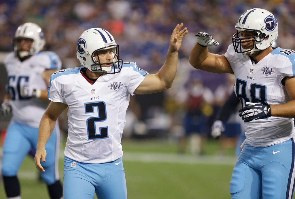 . Titans kicker Rob Bironas, left, celebrates with teammate Rashad Ross after kicking a 28-yard field goal during the first quarter against the Vikings. (AP Photo/Jim Mone)