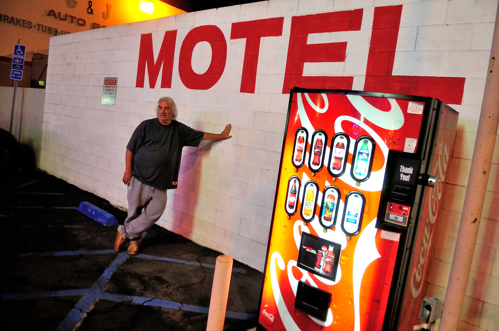 . Tim Grobaty leans on the parking lot wall of the Tower Motel across the street from the El Capitan Motor Inn.Photo by Thomas Wasper for the Press Telegram