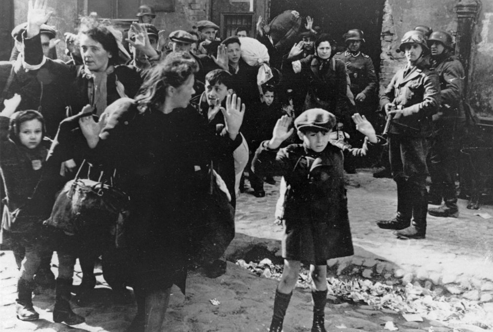 . In this April 19, 1943 file photo, a group of Jews are escorted from the Warsaw Ghetto by German soldiers. (AP Photo/File)