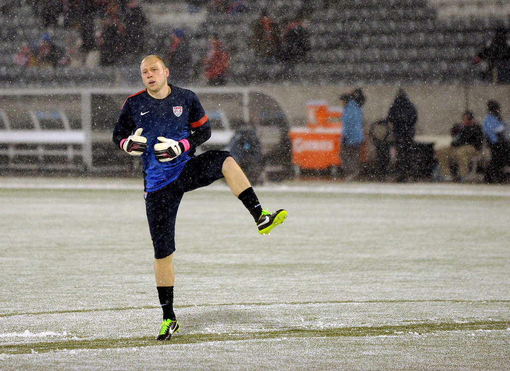 . COMMERCE CITY, CO. - MARCH 22: United States goalkeeper Brad Guzan (1) warmed up in the snow before the game. The U.S. Men\'s National Soccer Team hosted Costa Rica Friday night, March 22, 2013 in a FIFA World Cup qualifier at Dick\'s Sporting Goods Park in Commerce City.  (Photo By Karl Gehring/The Denver Post)