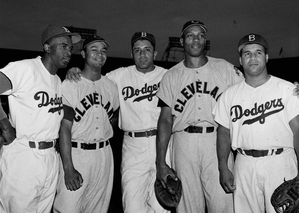 Description of . Black players on the Brooklyn Dodgers and Cleveland Indians teams pose at Ebbets Field in Brooklyn in this July 24, 1950 file photo. Left to right,  Jackie Robinson, Brooklyn; Larry Doby, Cleveland; Don Newcombe, Brooklyn; Luke Easter, Cleveland; and Roy Campanella, Brooklyn. Doby, who broke the color barrier in the American League in 1947, will be honored at the All-Star game in Cleveland on Tuesday, July 8, 1997.(AP Photo)