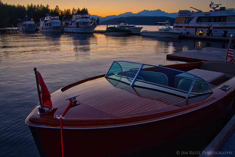 Someone parked their nice Chris Craft at the Alderbrook dock, at sunset.