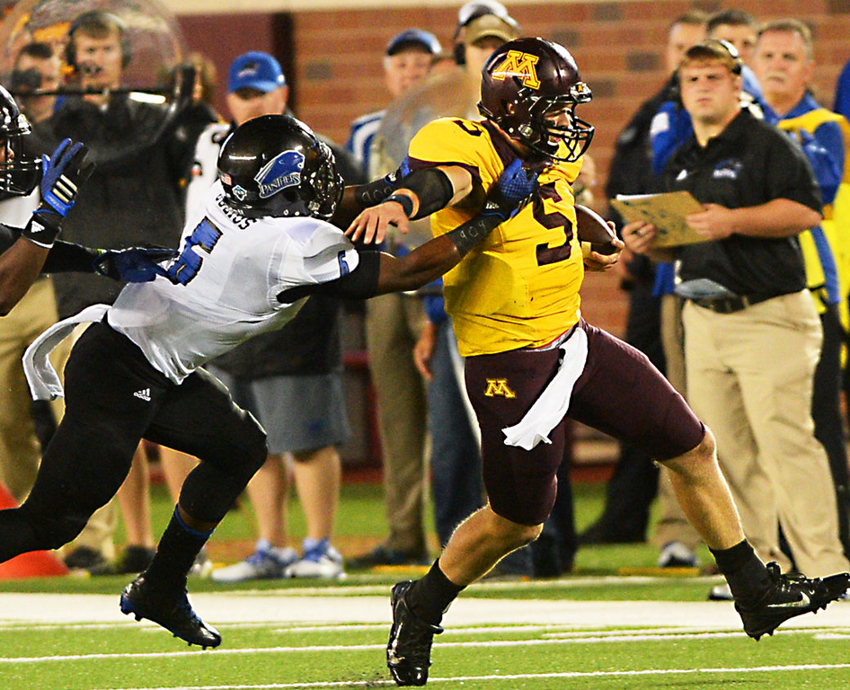 . Minnesota quarterback Chris Streveler gets pulled down by Eastern Illinois defensive back Cedric Julius after a first-down scramble in the fourth quarter. (Pioneer Press: John Autey)