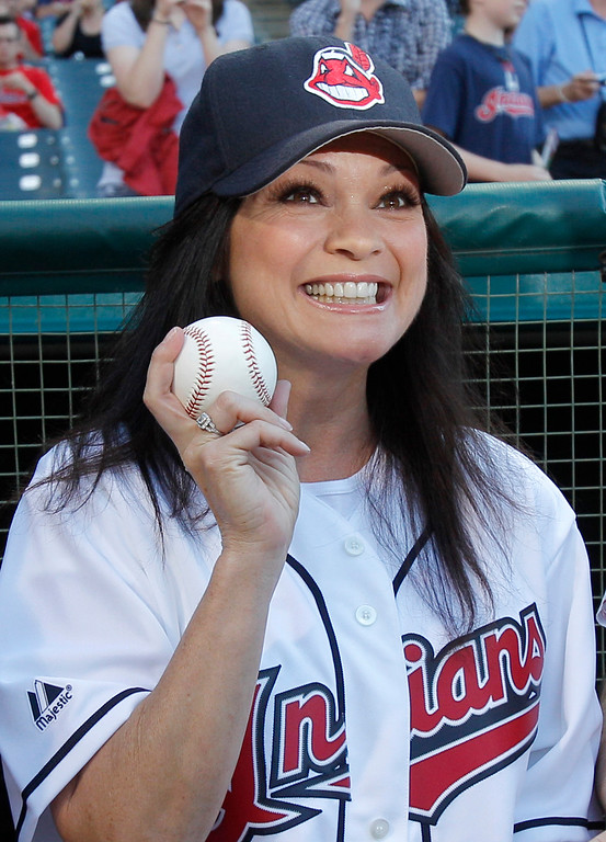 . Actress Valerie Bertinelli of the sitcom \'Hot in Cleveland\' shows of a baseball before throwing a ceremonial first pitch before the Cleveland Indians face the Pittsburgh Pirates in a baseball game in Cleveland on Friday, June 17, 2011.   (AP Photo/Amy Sancetta)