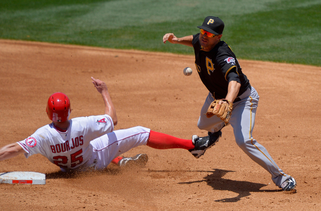 . Los Angeles Angels\' Peter Bourjos, left, is forced out at second, but breaks up Pittsburgh Pirates shortstop Jordy Mercer\'s double play attempt on a fielder\'s choice by Mike Trout and during the second inning of their baseball game, Sunday, June 23, 2013, in Anaheim, Calif.  (AP Photo/Mark J. Terrill)