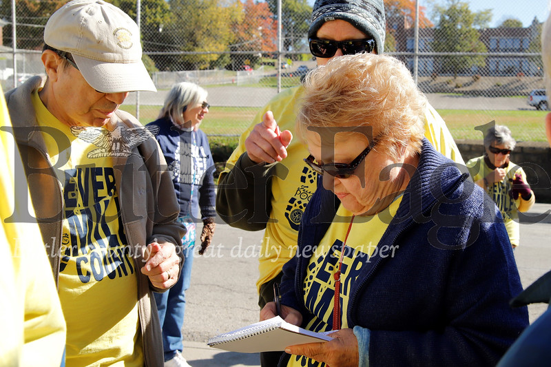 Walk For the Poor coordinator Paula Dorsch signs in walkers Saturday at St. Vincent de Paul Food Bank in Butler. Seb Foltz/Butler Eagle