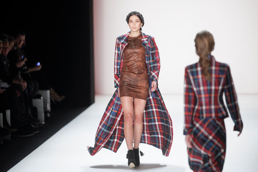 . Modesl present creations of Anja Gockel\'s Autumn Winter 2014 collection during the Mercedes Benz Fashion Week in Berlin, Wednesday, Jan. 15, 2014. (AP Photo/Markus Schreiber)