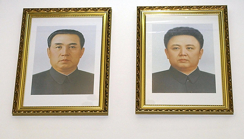 . This photo taken 28 February 2004 at the North Korean embassy in Beijing shows portraits on the wall of North Korea\'s late leader Kim Il-Sung (L) and current leader Kim Jong-Il.  It was reported 17 November 2004 that North Korean leader Kim Jong-Il has made his trademark visit to a frontline army unit amid reports that his portrait had been removed from some public places.      (KIM JAE-HWAN/AFP/Getty Images)