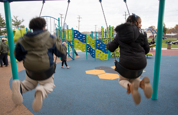 11/04/19 Wesley Bunnell | StaffrrA ribbon cutting was held at Chesley Park celebrating the completion of the Phase 2 renovation project. Children from Smalley Schoo on the swings.