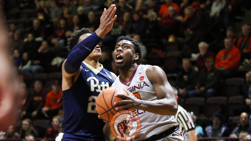 Justin Bibbs starts a layup attempts while being closely guarded in the first half. (Mark Umansky/TheKeyPlay.com)