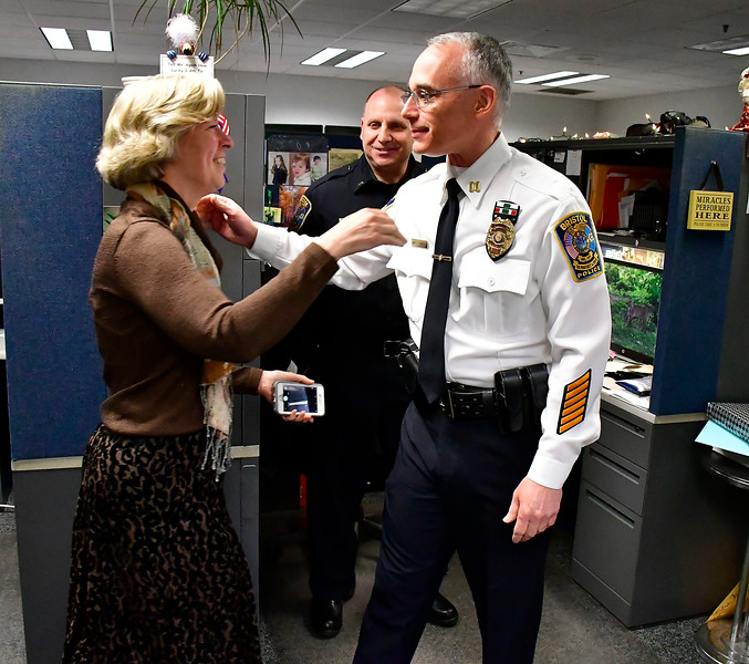 2/28/2019 Mike Orazzi | Staff Bristol Police Captain Thomas Calvello and his wife Allison for his retirement at police headquarters on Thursday.