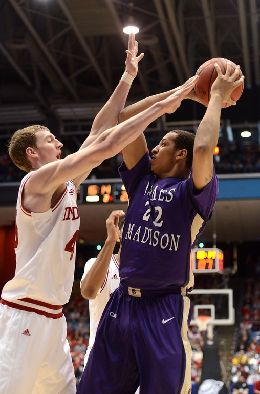 . DAYTON, OH - MARCH 22: Taylor Bessick #22 of the James Madison Dukes handles the ball against Taylor Bessick #22 of the James Madison Dukes in the second half during the second round of the 2013 NCAA Men\'s Basketball Tournament at UD Arena on March 22, 2013 in Dayton, Ohio.  (Photo by Jason Miller/Getty Images)