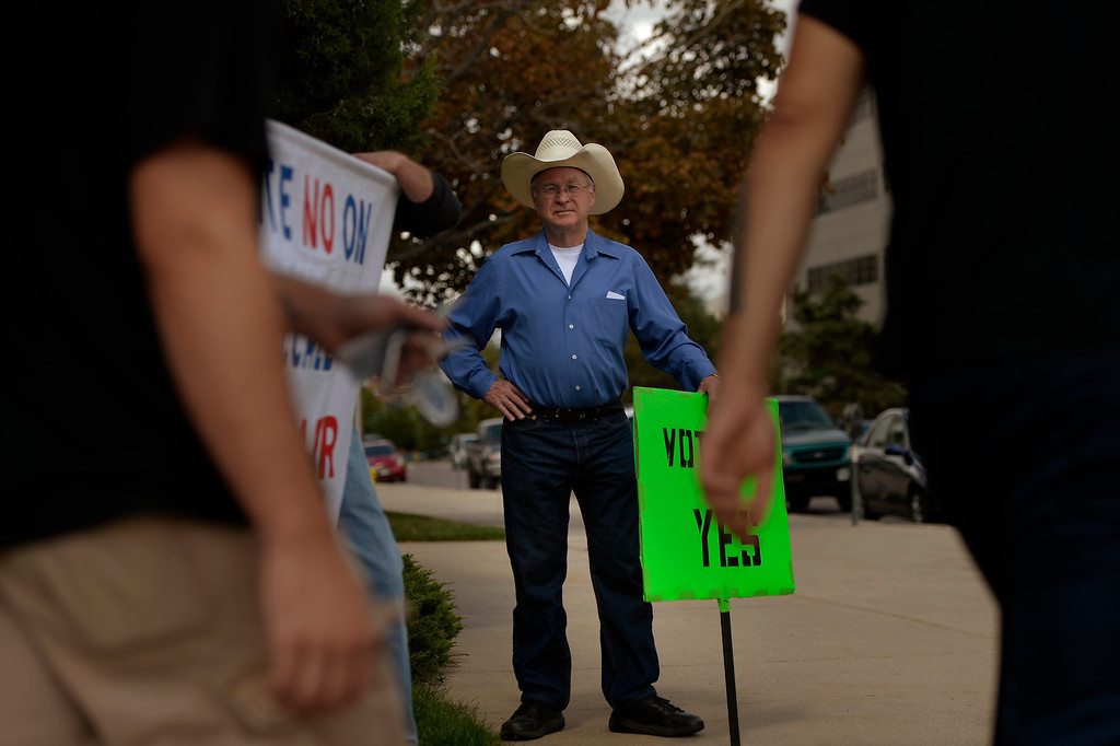 """. COLORADO SPRINGS, CO. - September 10: Tom Singer of Castle Rock stands with his \""""VOTE YES\"""" sign during the recall vote for Senate President John Morse at the Centennial Building in downtown September 10, 2013 Colorado Springs, Colorado. (Photo By Joe Amon/The Denver Post)"""
